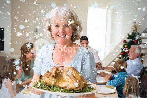 Composite image of happy grandmother with christmas meal
