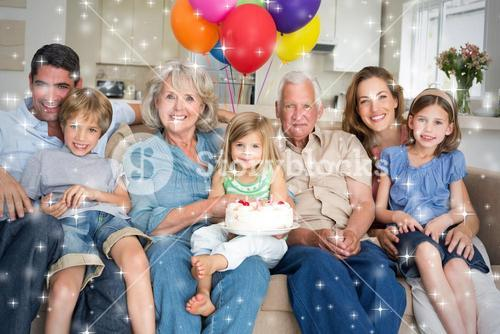 Composite image of multigeneration family celebrating girls birthday