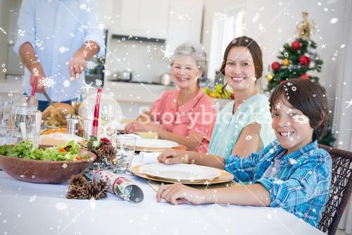 Composite image of family having christmas meal