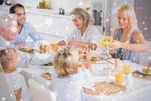 Composite image of happy family eating the thanksgiving dinner
