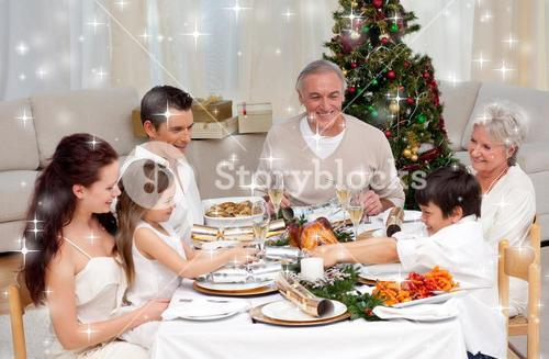 Composite image of brother and sister pulling a christmas cracker at home