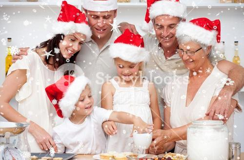 Family baking christmas cakes and sweets in the kitchen