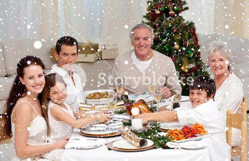 Composite image of children pulling a christmas cracker at home