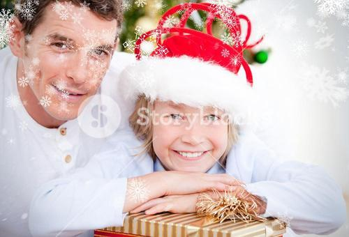 Composite image of bright father celebrating christmas with his son