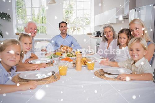 Composite image of family celebrating thanksgiving