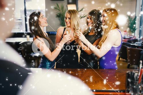 Gorgeous women clinking their flutes of champagne