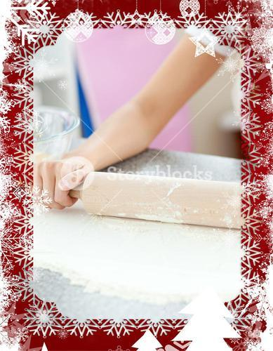 Composite image of smiling woman preparing a cake the kitchen