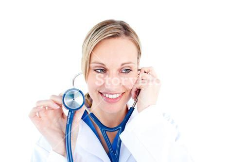 Radiant young female doctor holding a stethoscope