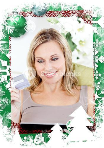 Composite image of delighted woman holding a card and a laptop