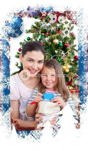 Composite image of mother and daughter at home at christmas time
