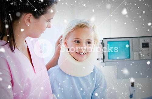 Composite image of adorable little girl with a neck brace sitting with her nurse