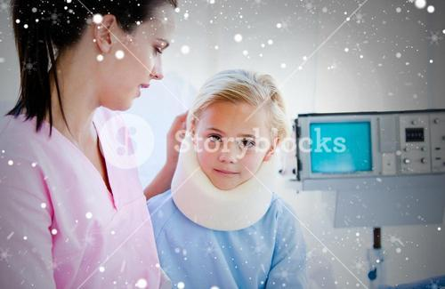 Sad little girl with a neck brace sitting with her nurse