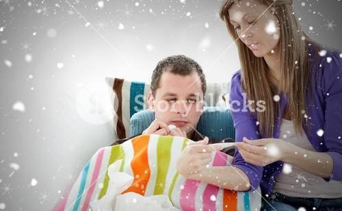 Caring woman check the temperature of her sick boyfriend with a thermometer again