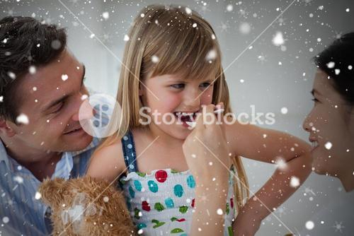 Composite image of smiling doctor giving medicine to a child