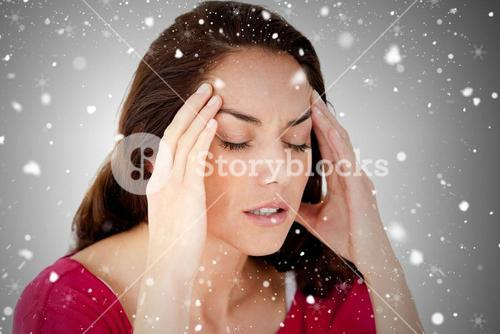 Composite image of beautiful woman having a headache