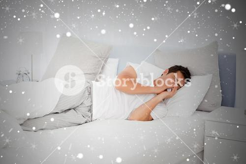 Composite image of sick man blowing his nose lying on his bed