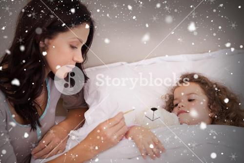 Composite image of mother taking her daughters temperature