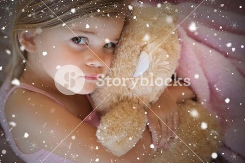 Close up portrait of a girl with stuffed toy