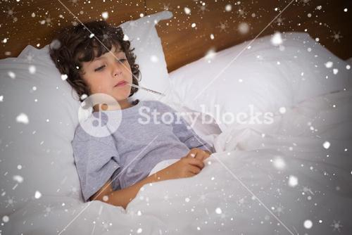 Composite image of sick child with thermometer resting in bed