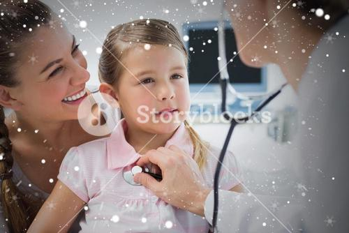 Girl being examined by female doctor