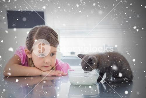 Composite image of girl looking at kitten drinking milk from bowl