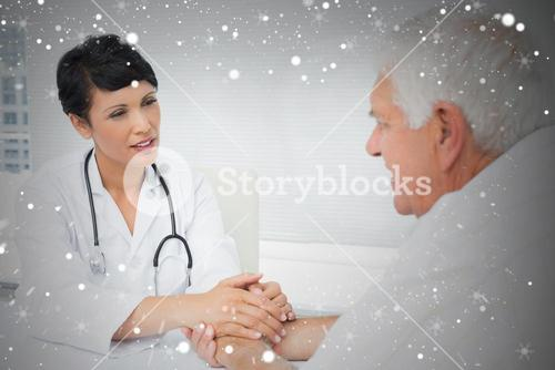 Composite image of female doctor holding senior patients hands
