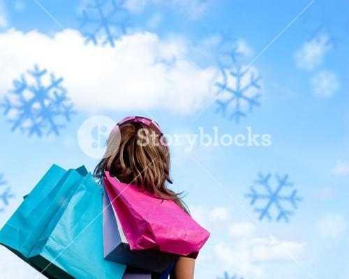 Composite image of woman holding shopping bags outdoor