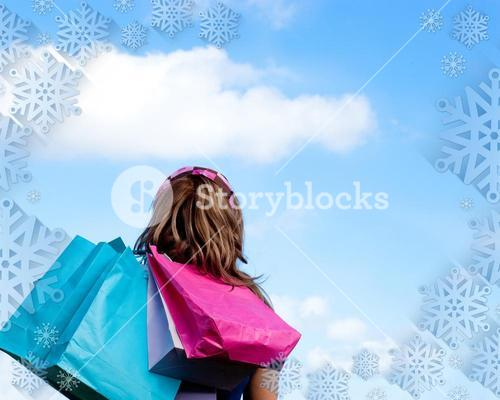 Woman holding shopping bags outdoor