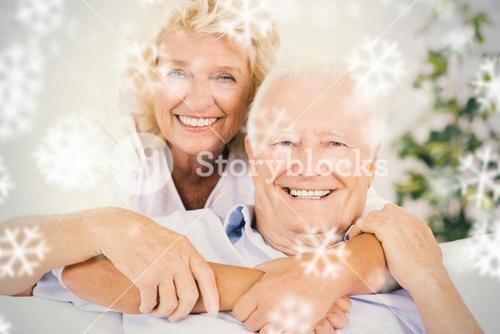 Composite image of happy old couple portrait hugging