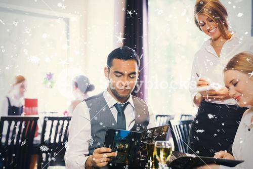 Composite image of two business people ordering dinner