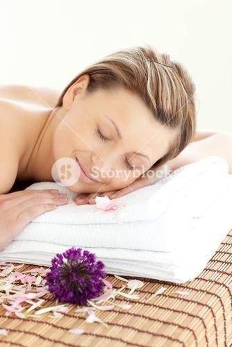 Close up of a radiant woman having a massage