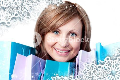 Composite image of young woman with shopping bags