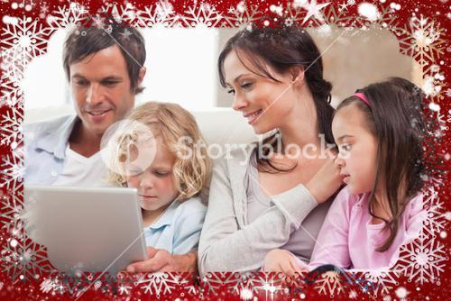 Composite image of serene family using a notebook
