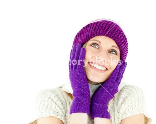 Captivating woman wearing cap and gloves