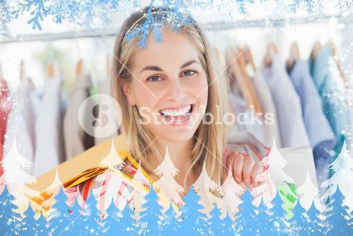 Composite image of cheerful woman standing in a clothing store