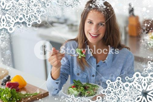Composite image of pretty woman eating a salad