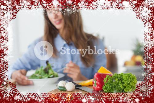 Composite image of pretty woman eating a vegetarian salad