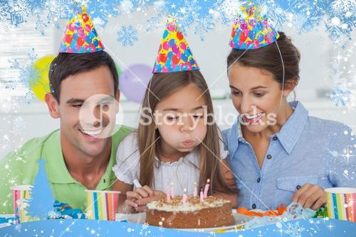 Composite image of little girl blowing out her candles