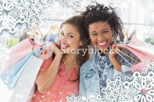 Young women with shopping bags in clothes store