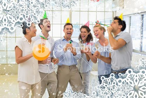 Casual business team celebrating with champagne and party poppers
