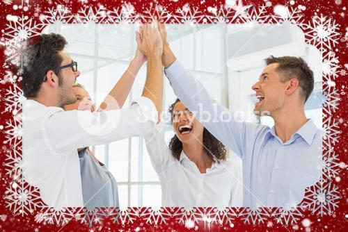 Composite image of casual business team high fiving