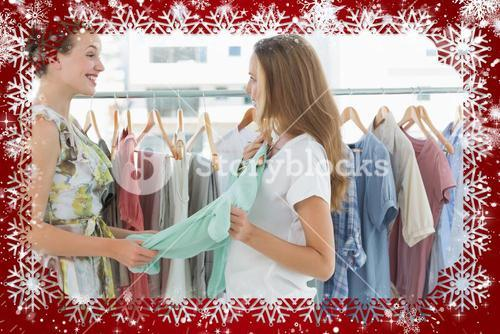 Composite image of women shopping in clothes store