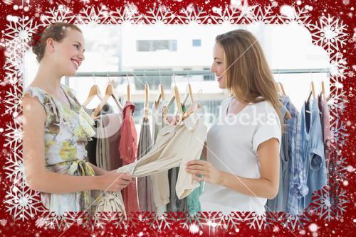 Composite image of young women shopping in clothes store