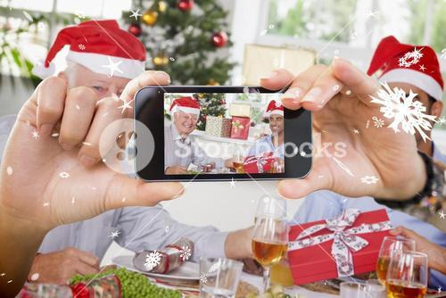 Hand holding smartphone showing photo