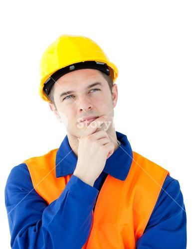 Pensive male worker wearing helmet