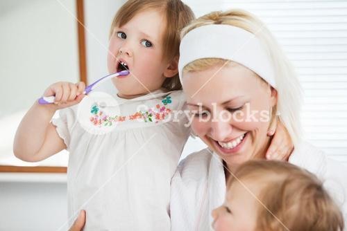 Attractive mother taking care of her children