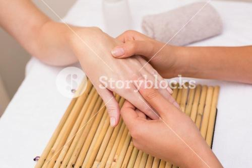 Woman getting a hand massage