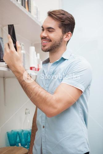Smiling hairdresser with hair products