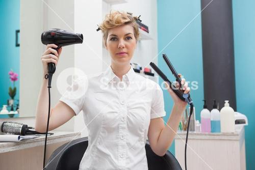 Customer holding a hairdryer