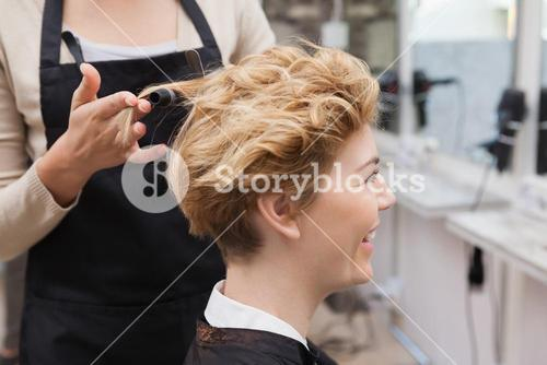 Customer getting her hair styled